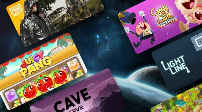 In the background, the earth and the moon are shown as seen from space. In the foreground, various game thumbnails are laid out. The games are PUBG Mobile, Candy Crush Friends Saga, Light Line, Juicy Pang, Cave FRVR, and more.